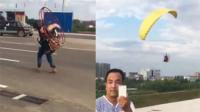 小伙背风扇自制人体滑翔机